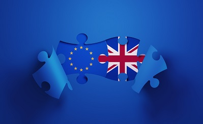 Jigsaw Puzzle Pieces Textured With European Union and British Flags