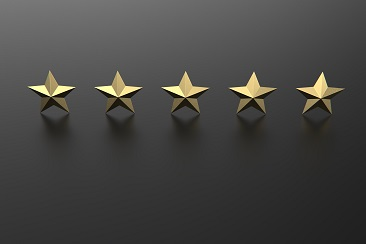 Five golden stars isolated against black, rating concept. 3d illustration stock photo